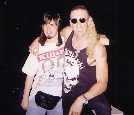 "Michael with Dee Snider in 1996. ""I regret the mullet, the goatee and, especially, the fanny pack. But meeting Dee was priceless,"" Mike says."